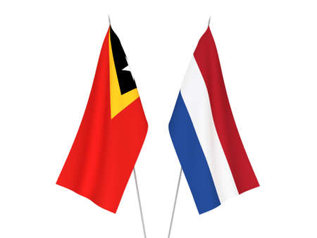 National fabric flags of Netherlands and East Timor isolated on white background. 3d rendering illustration. Foto de archivo