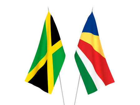 National fabric flags of Seychelles and Jamaica isolated on white background. 3d rendering illustration. Foto de archivo