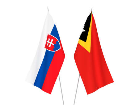 National fabric flags of East Timor and Slovakia isolated on white background. 3d rendering illustration. Foto de archivo