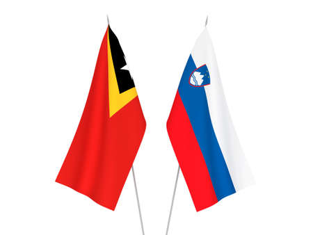National fabric flags of Slovenia and East Timor isolated on white background. 3d rendering illustration. Foto de archivo