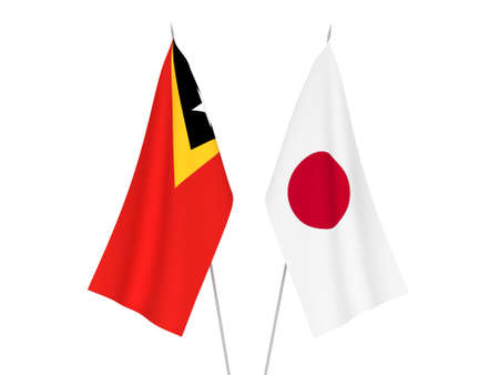 National fabric flags of Japan and East Timor isolated on white background. 3d rendering illustration. Foto de archivo