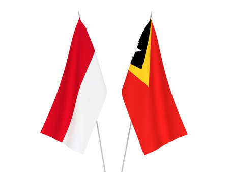 National fabric flags of East Timor and Indonesia isolated on white background. 3d rendering illustration. Foto de archivo
