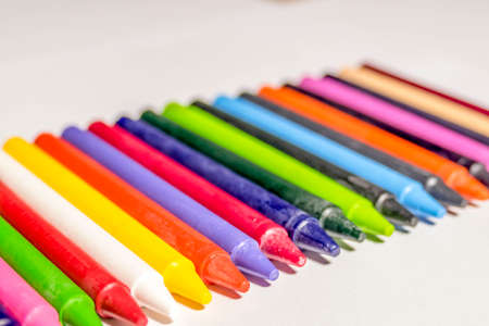 Colorful group of crayons/color pencil laying on the table. 免版税图像