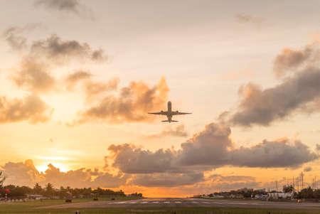 Plane taking off during sunset on st.maarten