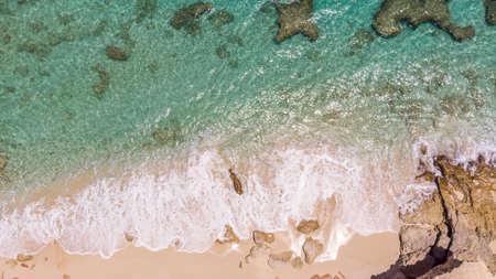Scenic aerial view of white sandy beach. White sandy beach in cupecoy St.Maarten