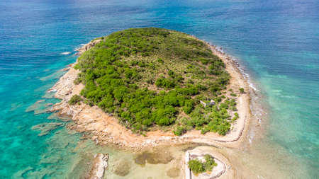 Aerial view of an empty small island in the caribbean.