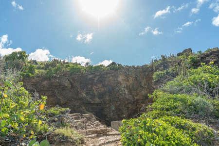 Natural caves created by the caribbean sea. Le trou de david. 免版税图像