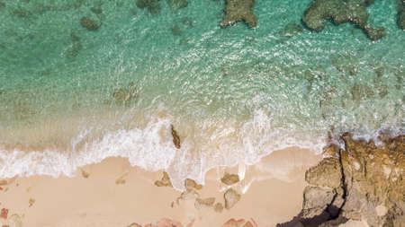 Scenic aerial view of white sandy beach.
