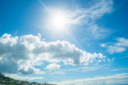 Beautiful white cloudy sky with the sun rising. 免版税图像