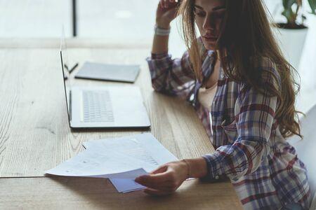 Frustrated brunette female freelancer has just got bad news