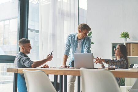 Happy three friends developing steps in business career 版權商用圖片