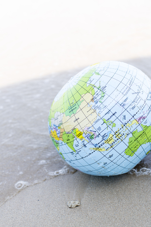 the silence of the world: globe water ball at the beach