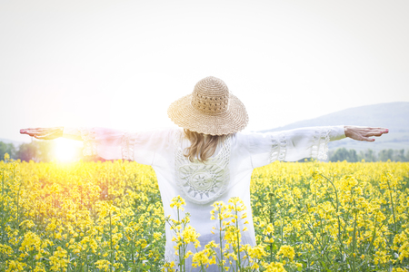young woman in a rape field Stock Photo