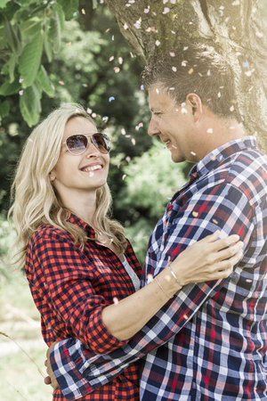 positiv: young laughing woman with his happy boyfriend and confettis
