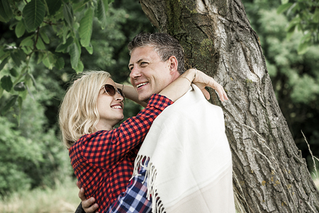 young laughing woman cluddling with his happy boyfriend