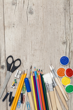 school accessories on a wooden background