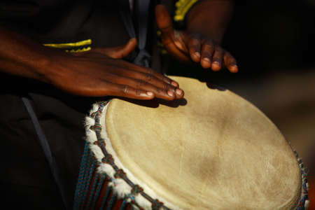 percussionist: African traditional drummer.