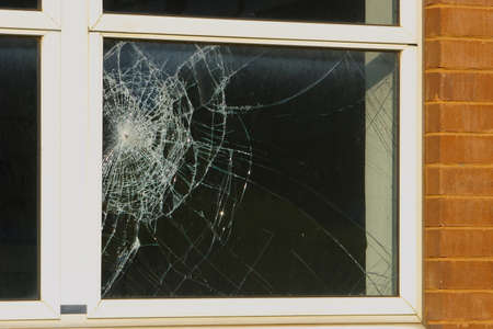 cracked glass: Crime scene - close up of a broken window