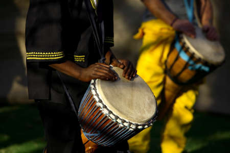 percussionist: African musician playing the drums, late afternoon. Stock Photo