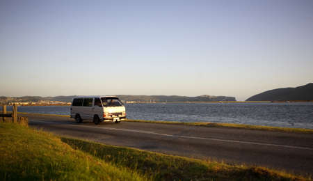 Mini bus taxi  tour operator traveling along a scenic road Knysna, South Africa Publikacyjne