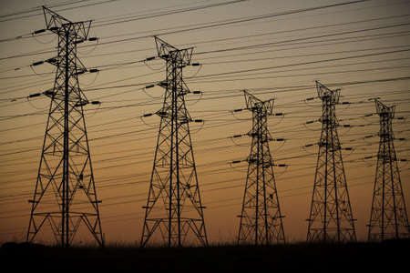 Electrical transmission power supply lines at dusk