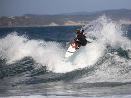 adrenaline: Adrenaline seeking surfer surfing in the ocean