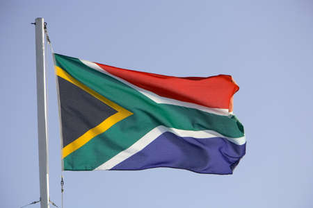 South African flag flying in a moderate breeze.