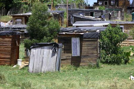 settlements: Wooden houses in an African informal settlement