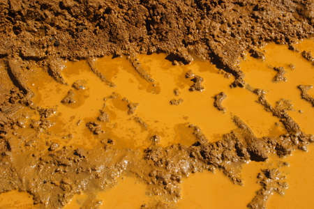 space weather tire: Large tractor, truck tyre tracks in the mud. Stock Photo