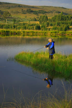flyfishing: Lady flyfishing in the late afternoon