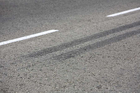 skid marks: Close up view of rubber tyre tracks on a tar road from vehicles braking harshly