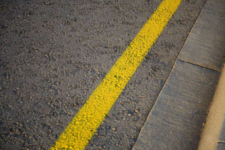 Yellow line at the side of a road.