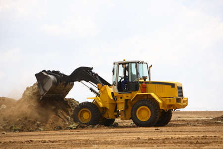 front end loader: Front end loader clearing a construction site Stock Photo