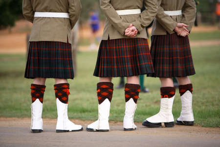 Three Scottish solders dressed in kilts Stock Photo
