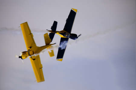 apprehension: Close flying airshow display focus on the rear aircraft. Stock Photo