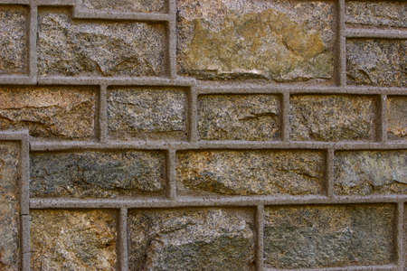 Close up view of a solid stone brick wall