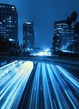 ロサンゼルス、都市高速道路交通が夕日に 写真素材