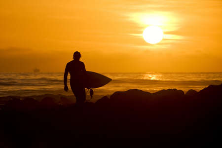 northshore: Sunset Surfer Stock Photo