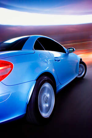 accelerated: Fast Sports Car with Motion Blur Stock Photo