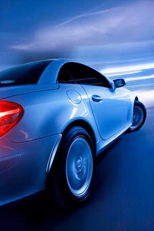 Schnelle Sportwagen mit Motion Blur Standard-Bild - 11928692