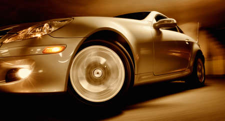 luxury cars: Fast Sports Car with Motion Blur Stock Photo