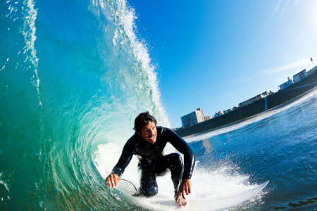 watersports: Surfer On Blue Ocean Wave