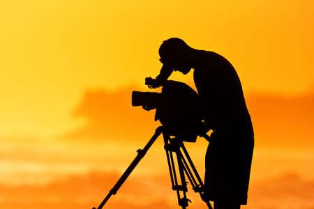 cinematographer: Camera Man, Professional Cinematographer at Sunset Stock Photo