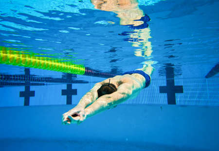 Swimmer in the Pool Underwater Stock Photo