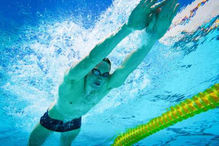 swimming underwater: Swimmer in the Pool Underwater Stock Photo