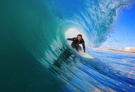 Surfer On Blue Ocean Wave photo