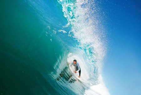 Surfer On Blue Ocean Wave Stock Photo - 11945988