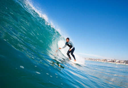 Surfer On Blue Ocean Wave Stock Photo - 11945980