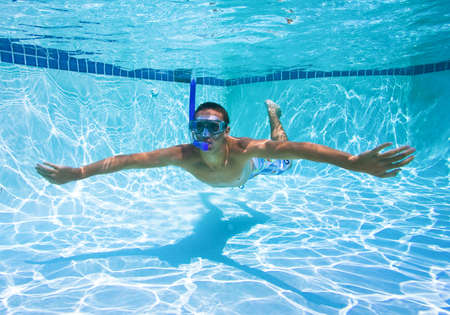 Young Man Swimming in Pool Underwater Stock Photo - 11946005