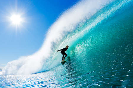 surfing beach: Surfer On Blue Ocean Wave